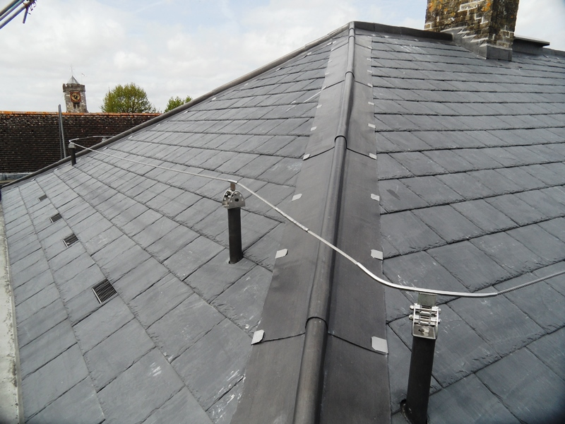 Bespoke mansafe system in the UK to slate roof. Fall-arrest safety line protection mansafe wire system through roof slate tiles, fitted in Salisbury Wiltshire