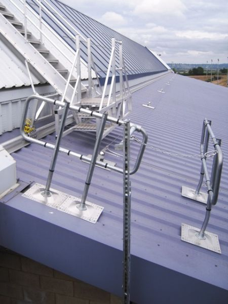 Ladder access fall arrest track system, with travelling anchor. Permanent roof access made safe. Vertical access.