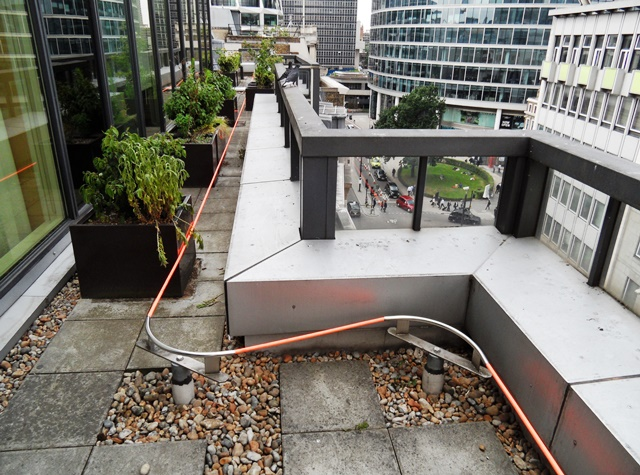 Completed installation of a fall-arrest man safe safety wire protection RoofSafe system in City of London