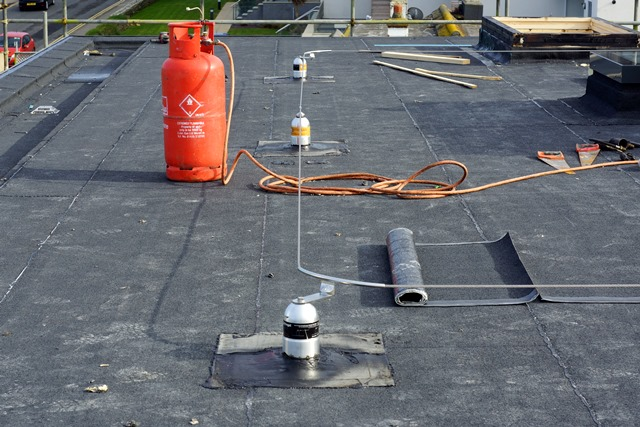 Fitted installation of permanent fall restraint anchor line wire system on Bitchumen roof and certificated