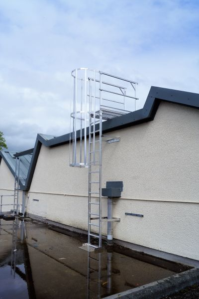 Fixed hooped ladder fall protection system. Aluminium design. Somerset installation. STQ Vantage