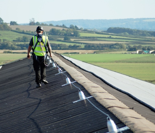 Lifeline Fall Protection Systems. London, surrey, portsmouth, southampton and reading. Man walking on roof. STQ Vantage.