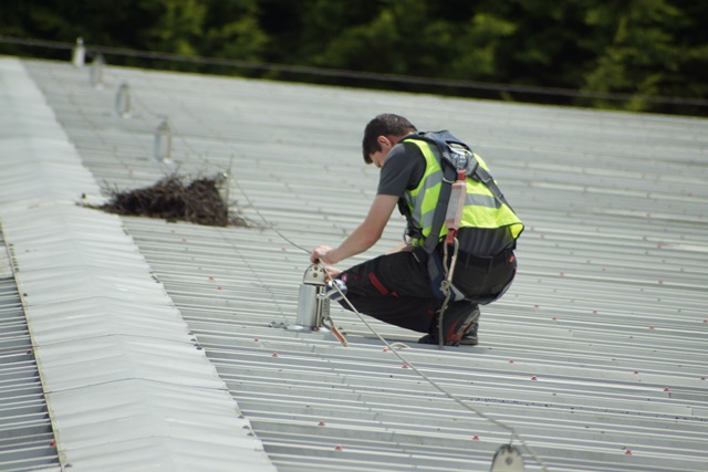 Lifeline system testing in Hampshire. Fall protection RoofSafe lifeline restraint wire system test and inspection in Hampshire. STQ Vantage horizontal lifeline safety inspection identifies defects with the lifeline system.