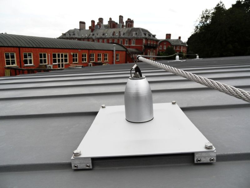 Mansafe system clamped to roof sheets. Permanent fall restraint anchor mansafe line. Surrey installations.