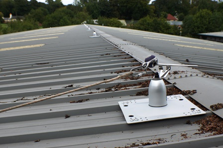 Horizontal lifeline anchor system. RoofSafe anchor system rivetted to the roof sheets. This ridge-positioned mansafe safety running line system was fitted to a metal roof profile to enable gutter access. Hampshire installations.