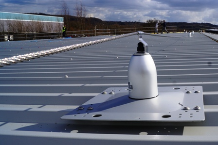Avonmouth Roofsafe lifeline fall-arrest system rivetted to metal roof profile. Uniline system installed by STQ Vantage, the height safety system specialists.