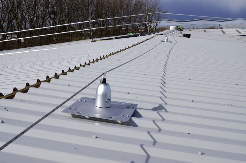 RoofSafe fall protection anchor lifeline system. This ridge line fall protection system was designed to enable total roof access.