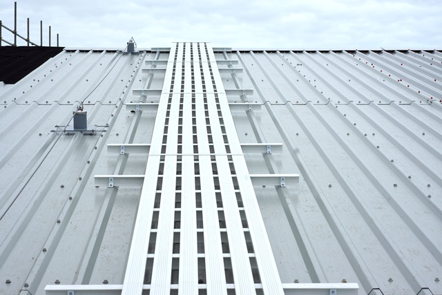 Roof Fall Protection Walkway integrated with roof safety line system running up the roof